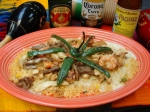 Tres Amigos - Grilled Chicken, Steak and Shrimp served over a bed of rice, garnished with a few slices of jalepeno peppers and topped with cheese dip.